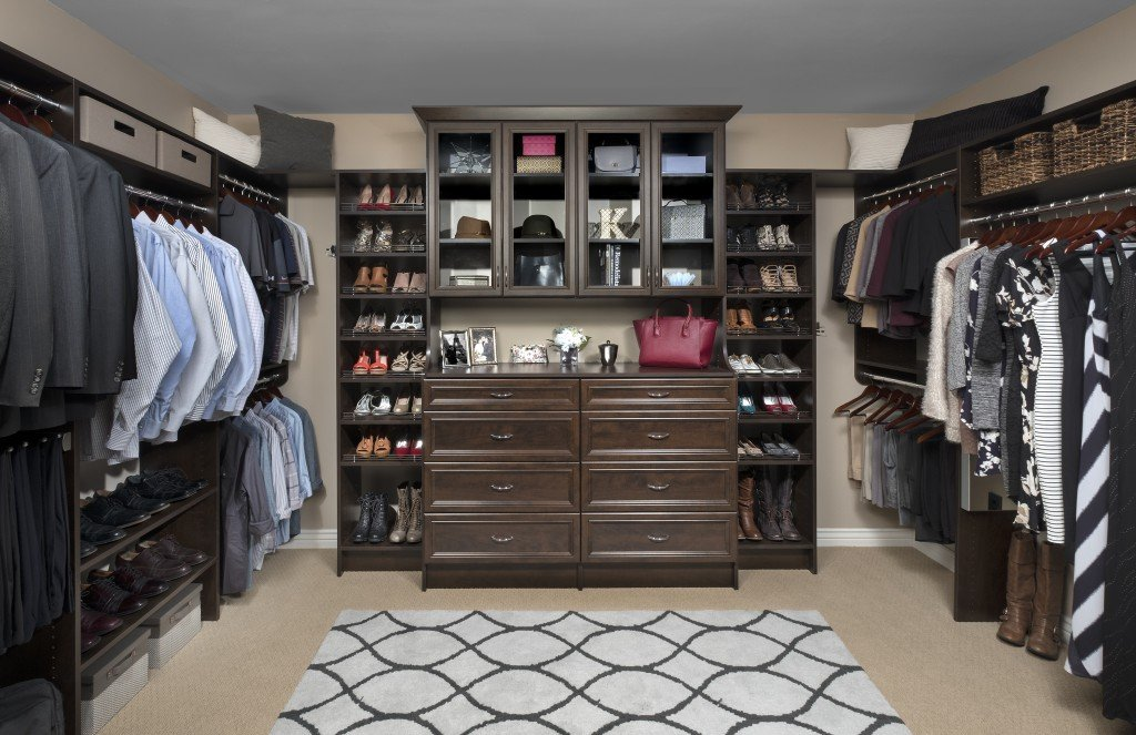 Custom Dark Wood Walk In Closet System